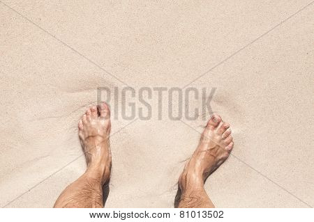 Wet Male Feet Stand On White Sand