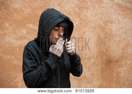Dark Young Woman Sad Standing And Smoking Near Urban Wall Portrait