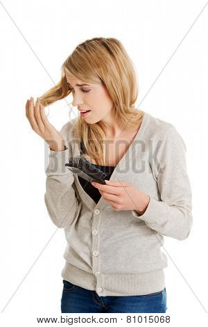 Stressed young woman loosing hair