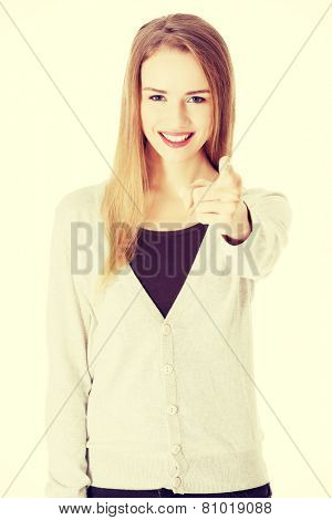 Beautiful smiling casual woman pointing on you