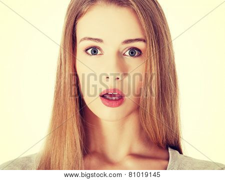 Beautiful surprised woman with open mouth.