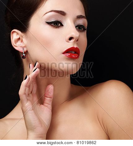 Beautiful Makeup Female Model With Black Eyeliner And Red Lipstick. Closeup