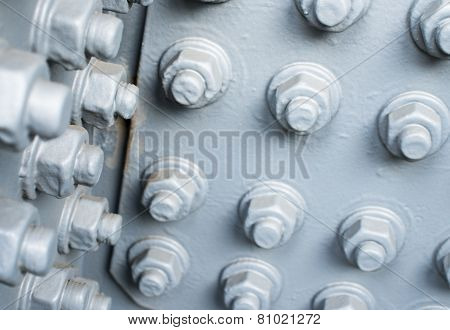 Gray Painted Metal Surface With Bolts And Nuts