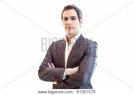 Portrait Of Young Smiling Businessman Wearing Business Suit And Glasses