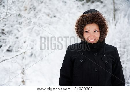 Cheerful Caucasian Young Woman in Snowy Weather, Copy Space