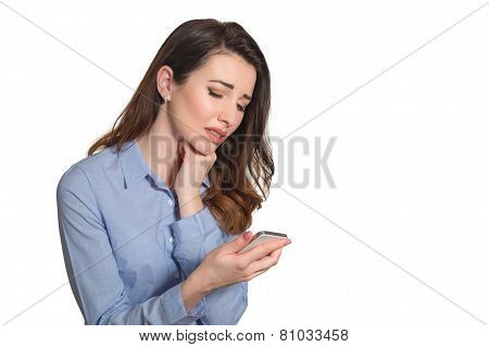 Troubled Woman Reading Bad News On Phone Touching Her Head In Misery Isolated On White
