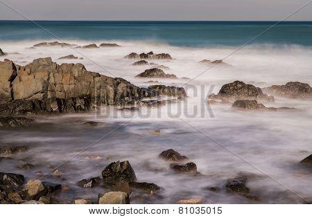 Long exposure stones on the beach