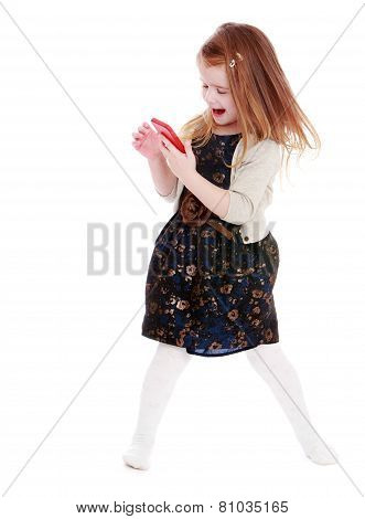 Cheerful little girl with a phone in his hand.