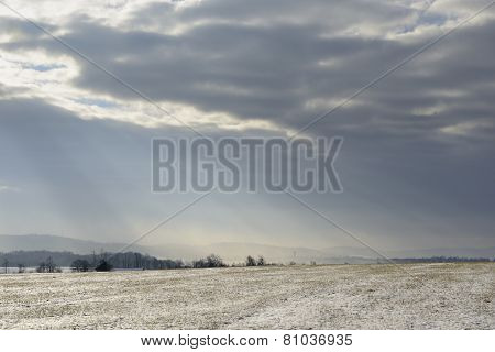 Field and Clearing Clouds after Snow
