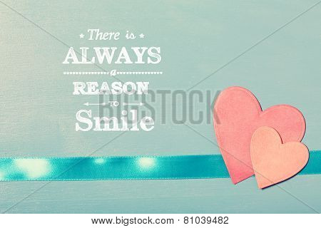 There Is Always A Reason To Smile Text With Pink Paper Hearts