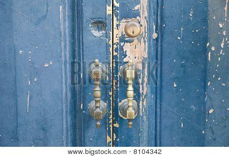 Closeup of brass handle of allwood door.