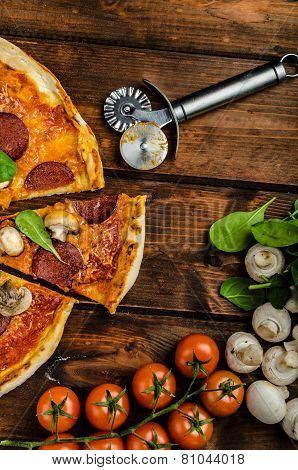 Rustic Pizza With Salami, Mozzarella And Spinach