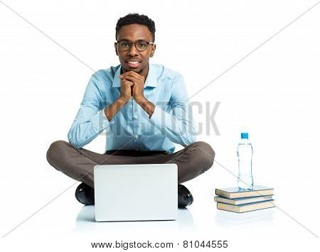 Happy African American College Student Sitting With Laptop On White
