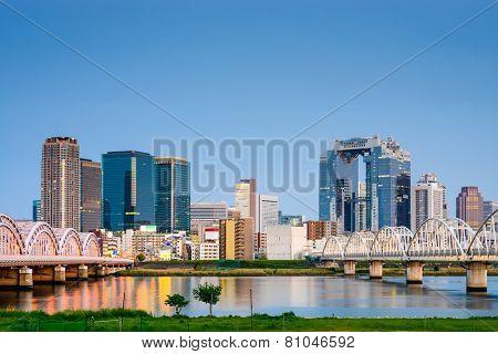 Osaka, Japan skyline at Umeda from across the Yodogawa River.