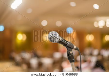 Microphone In Concert Hall Or Conference Room With Lights In Background. With Extremely Shallow Dof