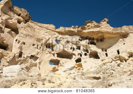 Detail of the ancient castle of Cavusin dug from a mountains, Cappadocia, Turkey