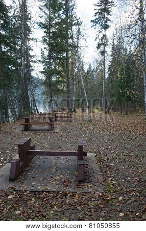 Picnic Area With Tables Alongside A Lake