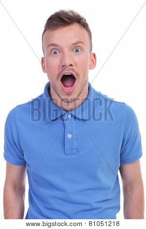 picture of a young casual man being amazed and left open mouthed. isolated on a white background