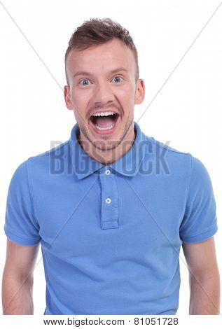 portrait of a young casual man acting surprised. isolated on a white background