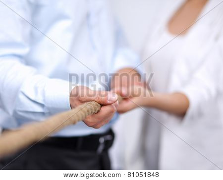 Concept image of business team using a rope as an element of the teamwork