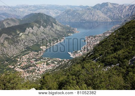 MONTENEGRO - JUNE 09, 2012: Panorama UNESCO World Heritage Site bay of Kotor with high mountains plunge into Adriatic sea and historic town of Kotor, Montenegro on June 09, 2012