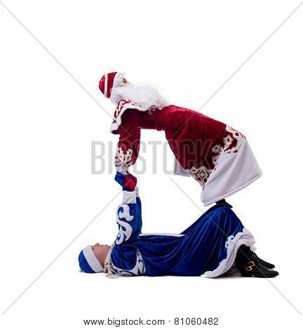 Acrobatic performers posing in Christmas costumes