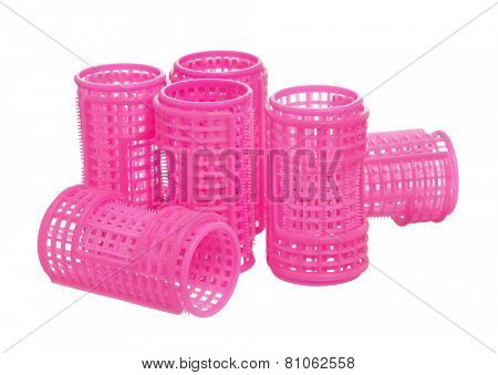 Few pink hair curlers, isolated on white background
