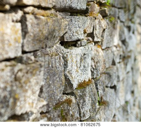 Old Stone Moss-grown Masonry With Rich Texture