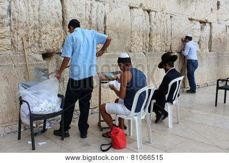 Collecting the notes at Western Wall in Jerusalem