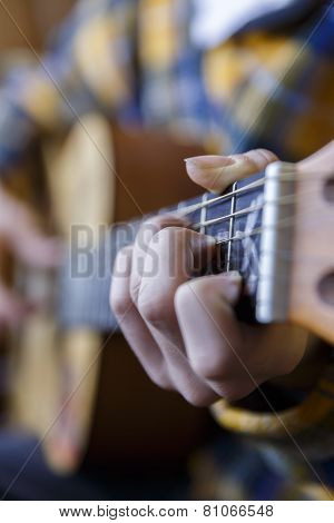 Young Guy Playing Classical Guitar