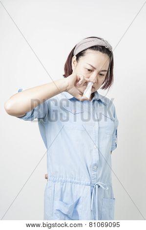 Women Spray Into Nasal