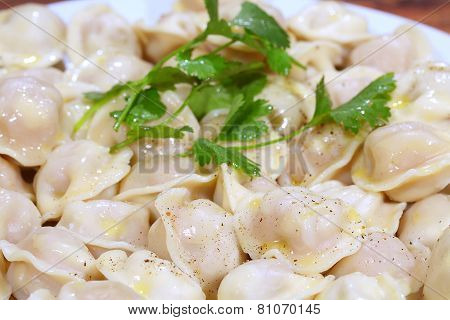 Pelmeni With Butter And Ground Pepper, With A Parsley Branch