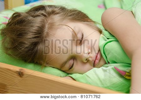 Portrait Of Young Girl Sleeping In Bed