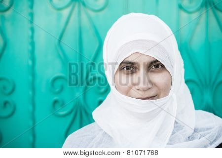Arabic Muslim Middle Eastern woman in white