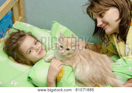 Mom And Daughter In The Morning Awake Cat