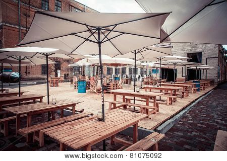 parasols on wooden tables