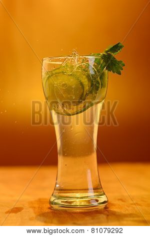 Full Glass Of Fresh Cool Tonic With Lime Fruits Isolated On Background