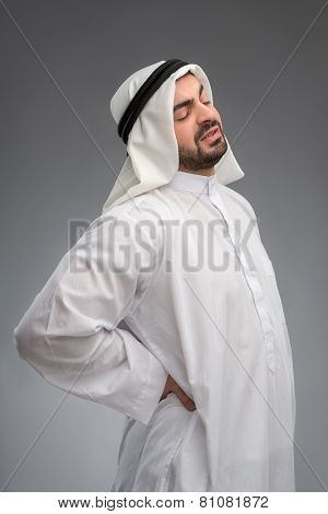 Middle aged Arab touching his aching waist