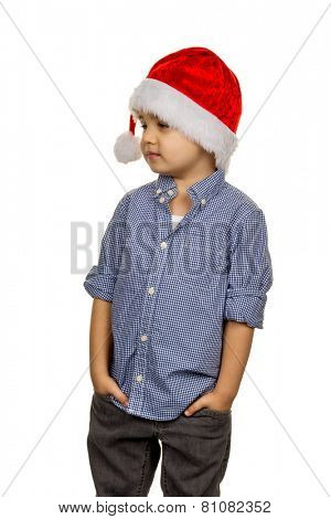 little boy with santa hat, a symbol of childhood, christmas, permeability