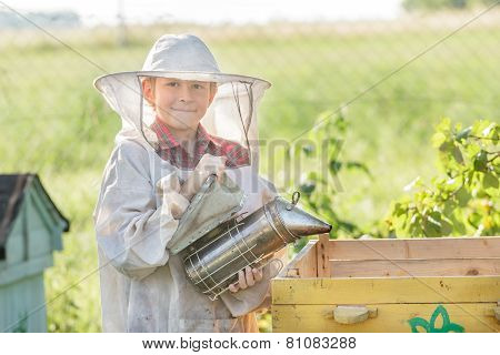 Teenage Beekeeper Wearing Protective Clothing