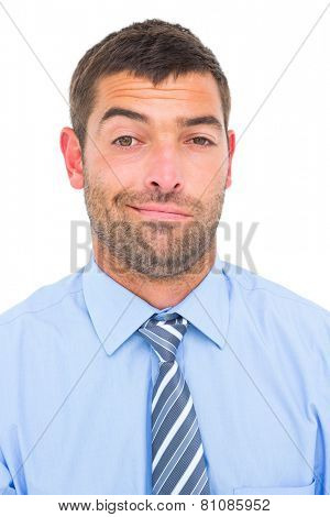 Businessman looking at the camera on white background