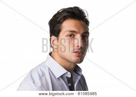 Formal Portrait Of Young Man In Shirt Looking At Camera
