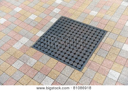 Metal Drain Surrounded By Tiles