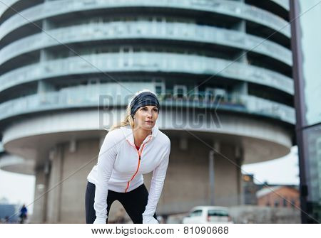 Female Jogger Taking A Break