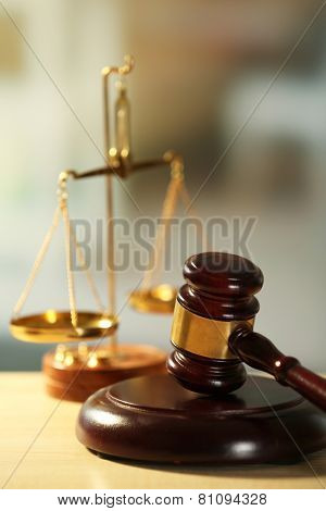 Wooden judges gavel on wooden table, close up