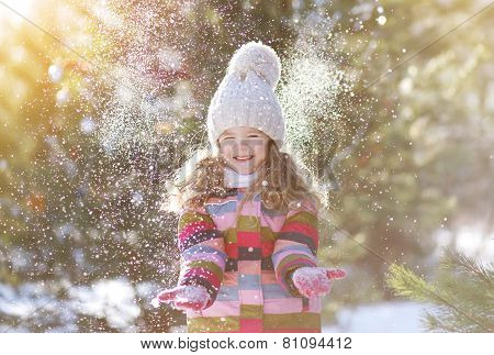 Joyful Child Having Fun With Snow In Winter Day
