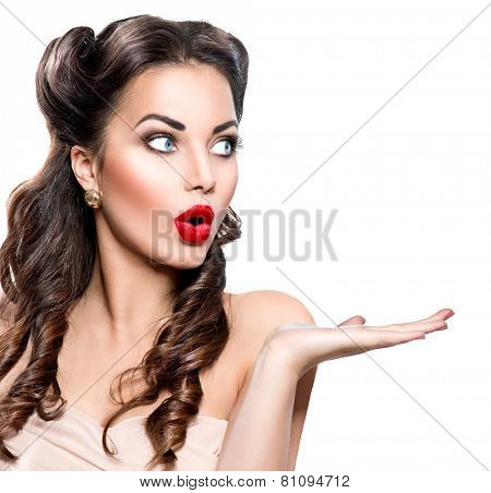 Surprised Retro woman portrait. Beauty vintage girl showing empty copy space on the open hand palm for text, isolated on white background. Proposing a product. Gestures for advertisement.