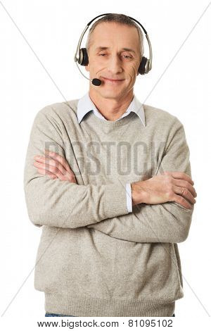 Mature call center man wearing headset.