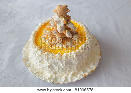 Birthday cake with whipped cream and biscuits