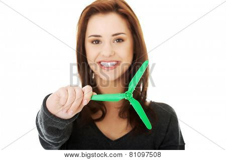 Caucasian happy woman holding small windmill